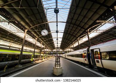 LUZERN, SWITZERLAND - JAN 29, 2017:  Luzern station platform with no people and an intercity express train awaiting departure