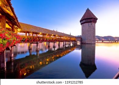 Luzern wooden Chapel Bridge and tower dawn view, town in central Switzerland