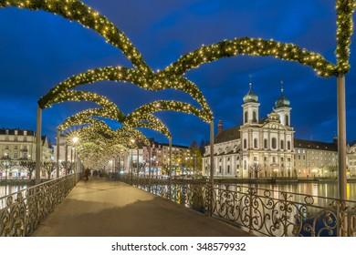 Luzerne City, Jesuitenkirche (Jesuit Church) at Night from Rathaussteg Walking Bridge with Christmas light decoration near Kapellbrucke Chapel Bridge, Switzerland