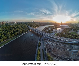 Luzhniki stadium, Moscow river and metro bridge on Sparrow Hills (Vorobyovy Gory) at sunset in Moscow, Russia on may. Aerial drone view
