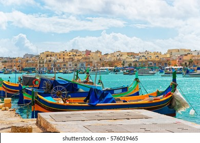 Luzzu colorful boats at Marsaxlokk Bay on Malta island