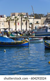 Luzzu, traditional Maltese fishing boats in the small, historic fishing village of Marsaxlokk , Southern Malta
