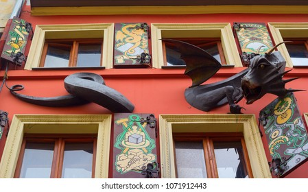 """Lviv (Lvov), Ukraine, October 2017: The facade of the famous restaurant """"House of Legends"""", a sculpture of a dragon."""