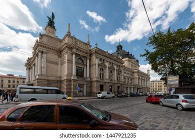 LVIV, LVIV OBLAST, UKRAINE - 2018/07/07: Tourists outside the Lviv Theatre of Opera and Ballet in Lviv, Western Ukraine