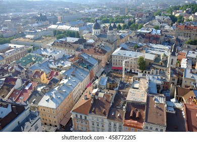 Lviv old city vintage panorama with houses roofs top view, Lviv, Ukraine. Retro travel industrial photo background.