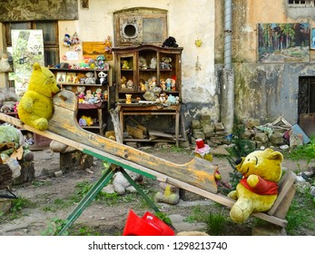 Lviv / Ukraine - 05 06 2018: two soft bears toys sitting on seesaw, Yard of Lost toys, obscure touristic place with old used plush children toys left behind, Lviv city, western Ukraine, Eastern Europe