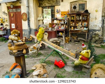 Lviv / Ukraine - 05 06 2018: two soft bears toys sitting on seesaw, Yard of Lost toys, obscure touristic place with old used plush children toys left behind, Lviv city, western Ukraine, Central Europe