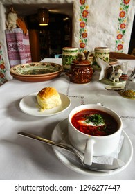 Lviv / Ukraine - 05 07 2018: delicious red borscht soup being served with garlic bread in traditional restaurant with rural decoration in Lviv city, western Ukraine, Eastern Europe