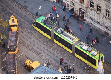 Lviv. Ukraine. 06.11.2018. View of the Market Square in Lviv from the height of the city hall tower. Lviv tram. People on the street, top view