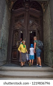 Lviv / Ukraine - 06/19/2018: People are visiting The Sts. Peter and Paul Church of the Jesuit Order.