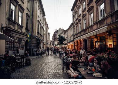 Lviv / Ukraine - 23th august 2018. Vintage paveme street of the old town in Lviv. homeless, comfortable and warm restaurants on sides.  visit card of Lviv - gastrological pleasure and beautiful girls.