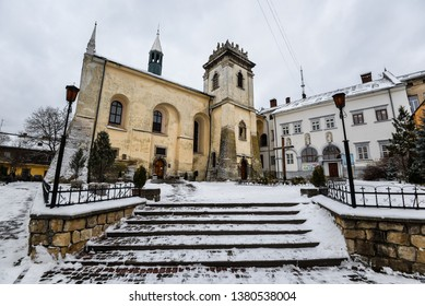 Lviv, Ukraine - 25 December, 2018: Winter view on All Saints Cathedral and Benedictine Monastery in Lviv old town, Ukraine