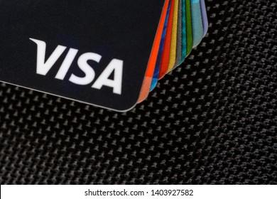 Lviv, Ukraine - 26 April 2019 : Close-up of Visa credit cards placed on a dark background