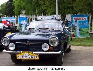 "LVIV, UKRAINE, 5 MAY 2012: CIRCA - International festival of retro cars in Lviv ""Leopolis Grand Prix"". Road name ""Lviv triangle"". Car ""Fiat""; Lviv, May 5, 2012"