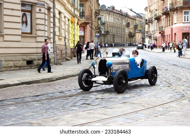 "LVIV, UKRAINE, 5 MAY 2012: International festival of retro cars in Lviv ""Leopolis Grand Prix"" - Road ""Lviv triangle"". Car - ""Bugatti"" in blue color. Lviv, Ukraine, May 5, 2012"