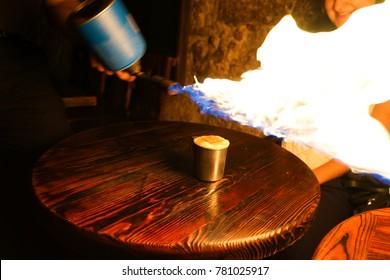 Lviv, Ukraine. 6 December 2017. Coffee Served With Flamethrower at Lviv Coffee Manufacture