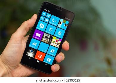 LVIV, UKRAINE - apr 06, 2016:  Microsoft Lumia 640 Windows Phone with icon on screen in hand