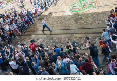 Lviv , Ukraine - April 09 2018: ?elebrations Clean Monday , a Ukrainian Christian tradition celebrated on the first day after Easter. Young people spray water on one another and  funy