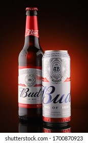 LVIV, UKRAINE - April 10, 2020: Bud beer in different containers red background