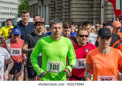 LVIV, UKRAINE - APRIL, 2016: Participants of marathon athletes run start take on Prospect of Freedom in Lviv, Ukraine