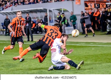 LVIV, UKRAINE - APRIL, 28th - 2016: Darijo Srna of Shakhtar Donetsk in the fight of ball with Coke of FC Sevilla during the UEFA EUROPE LEAGUE 1-st Semi-Final match at Arena Lviv stadium