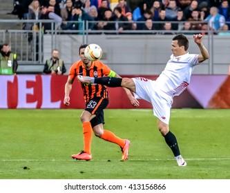 LVIV, UKRAINE - APRIL, 28th - 2016: Yevhen Konoplyanka of FC Sevilla in the fight of ball with Darijo Srna of FC Shakhtar during the UEFA EUROPE LEAGUE 1-st Semi-Final match at Arena Lviv stadium