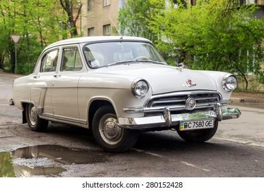 Lviv, Ukraine, April 29, 2015: GAZ 21 Volga 1st Series vintage car (released circa 1957 in USSR) parked on the street.