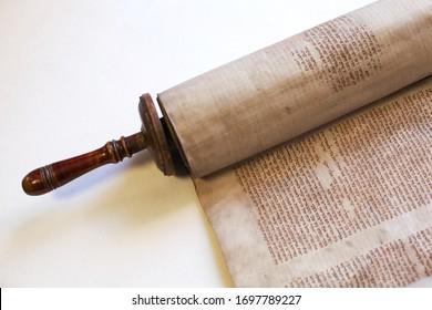 LVIV, UKRAINE - April 3, 2020: Old torah scroll book close up detail. Torah Jewish People. The Torah- the first five books of the Jewish scriptures