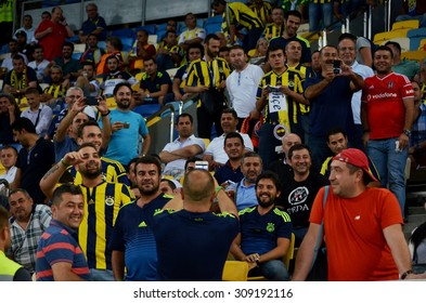 LVIV, UKRAINE - AUG 5: Active Turkish Fenerbahce fans in T-shirts before the UEFA Champions League match between Shakhtar vs Fenerbahce, 5 August 2015, Arena Lviv, Lviv, Ukraine