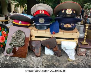LVIV, UKRAINE - AUGUST 13, 2020: Soviet and Ukrainian military caps at a flea market in the center of Lviv
