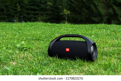 Lviv, Ukraine – August 17: JBL boombox black portable bluetooth speaker on grass on 08/17/2018 in Lviv