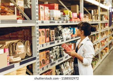 LVIV, UKRAINE - August 31, 2018: woman choosing products in grocery shop