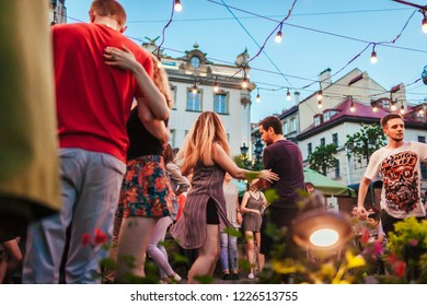 Lviv, Ukraine - August 4, 2018. People dancing salsa and bachata in outdoor cafe by Diana in Lviv