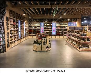"""LVIV, UKRAINE - DECEMBER 01: Wine bottles on the shelves in the supermarket """"Silpo"""" on December 01, 2017 in Lvov, Ukraine"""