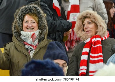 LVIV, UKRAINE - December 07, 2017: Spain Athletic Bilbao fans in the stands with attributes support the team during the UEFA Europa League match between Zorya Luhansk vs Athletic Bilbao, Ukraine
