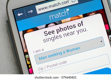 LVIV, UKRAINE - Feb 16, 2016: Hand holding white Samsung Smart Phone with match application, Match is a popular dating site