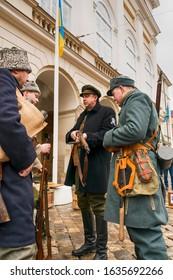 Lviv, Ukraine - February 02, 2020: Military historical reconstruction The November revolution . Soldiers inspect personal weapons   Lviv, Ukraine.