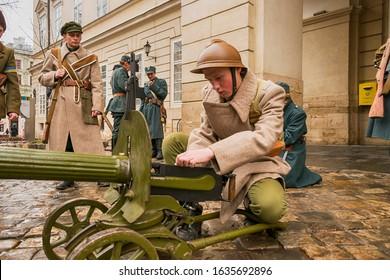 Lviv, Ukraine - February 02, 2020: Military historical reconstruction The November revolution . Soldier is preparing a machine gun   Lviv, Ukraine.