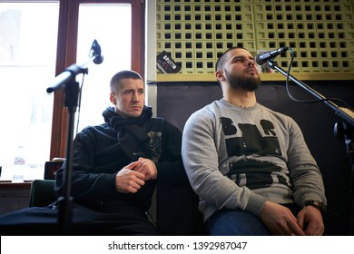 LVIV, UKRAINE - February 13, 2015: a rock band Brutto is working in studio. vocalists Vitaly Gurkov and Sergey Brazil is singing