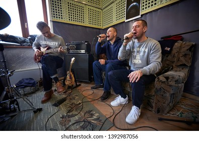 LVIV, UKRAINE - February 13, 2015: a rock band Brutto is working in studio. vocalists Siarhei Mikhalok and Petr Losevskiy Petya Aist is singing
