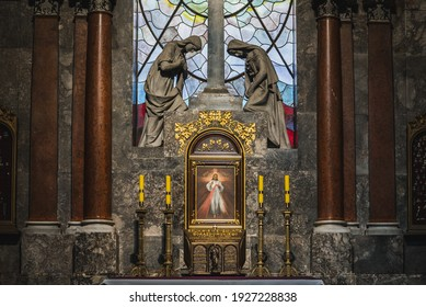 LVIV, UKRAINE - FEBRUARY 13, 2021: Interior of The Archcathedral Basilica of the Assumption of the Blessed Virgin Mary. Stained glass. The chapel of Divine Mercy and Our Lady of Perpetual Help.