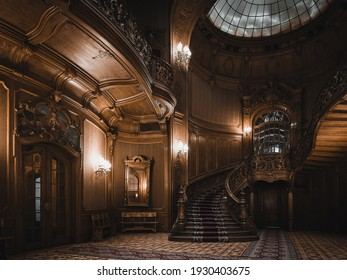 LVIV, UKRAINE - FEBRUARY 13, 2021: The building of the former noble casino, now the House of Scientists. Interior of the magnificent mansion with ornate wooden staircase and atrium in the great hall.