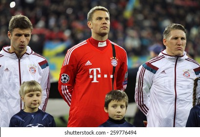 LVIV, UKRAINE - FEBRUARY 17, 2015: FC Bayern Munich players looks on before UEFA Champions League game against FC Shakhtar Donetsk at Arena Lviv stadium