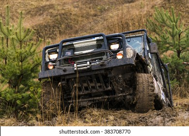 Lviv, Ukraine - February 21, 2016: Off-road vehicle UAZ  overcomes the track on of landfill near the city Lviv.