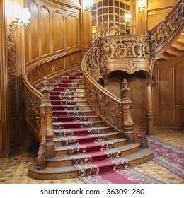 LVIV, UKRAINE - JANUARY 15, 2016: House of Scientists in Lviv, Ukraine. Vintage wooden spiral staircase.