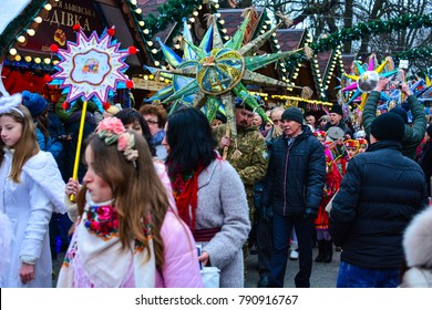 "Lviv, Ukraine - January 8, 2018: Ukrainians celebrate Christmas with traditional Kolyada festival ""The flash of Christmas star"". The Ukrainian soldier carries the main star of the event named ""Heroic"""