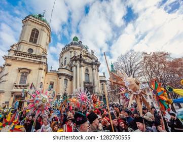 "Lviv, Ukraine - January 8, 2019: Celebration of  Orthodox Christmas in Lviv. Festival ""The flash of Christmas star"". Parade of Christmas stars."
