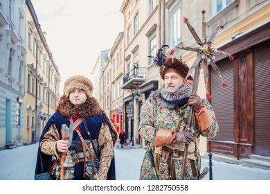 "Lviv, Ukraine - January 8, 2019: Celebration of  Orthodox Christmas in Lviv. Festival ""The flash of Christmas star"". Parade of Christmas stars. Cossacks on parade."