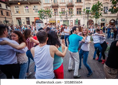 Lviv, Ukraine - July 15, 2017: Salsa dancers in outdoor cafe near Diana fountain at Market square in Lviv