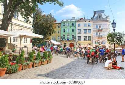 LVIV, UKRAINE - JULY 17, 2015: People gathered on the Market (Rynok) square to take part in the All-Ukrainian Charity bike ride with the participation of blind people, Lviv, Ukraine